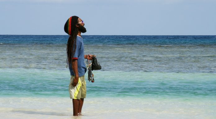 Jamaican man overlooking the sea